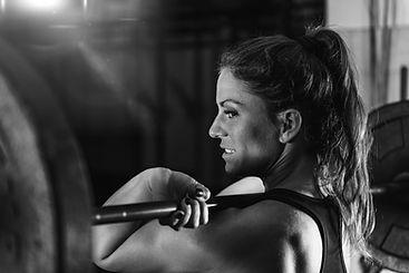 cross-training-female-athlete-lifting-we