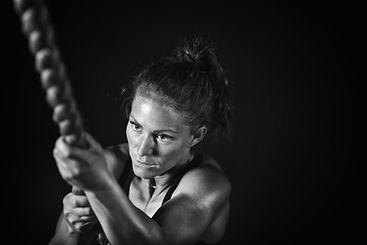 woman-athlete-exercising-on-gymnastic-ri