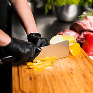 cook-cutting-yellow-pepper-board_23-2148
