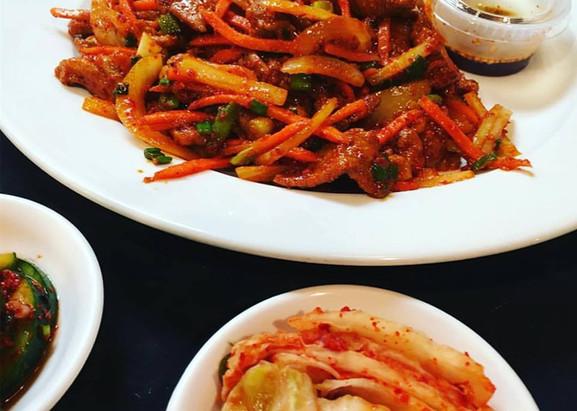Spicy Pork with Kimchi Sides