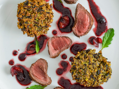 CORIANDER CURED VENISON TENDERLOINS WITH WILD RICE FRITTERS AND DRIED BLUEBERRY SAUCE