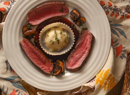 """FENNEL CRUSTED VENISON LOIN W/ CHESTNUT """"RAVIOLI'"""", ROASTED MUSHROOMS AND A PORT WINE REDUCTION"""