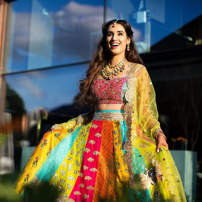 The multicolored lehenga and choli paired with a net dupatta