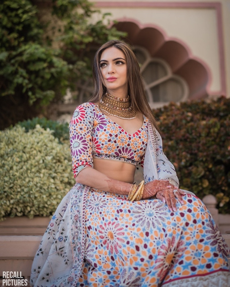 5. An ivory based lehenga with multicolored embroidery and hand-printed work on it