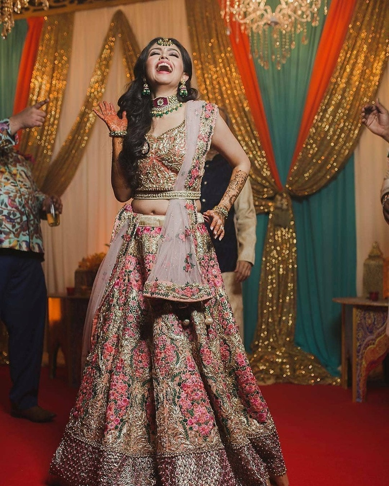 3. A dusty pink lehenga choli with pink and green embroidery paired with a plain net dupatta