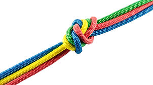 Tie from colorful ropes isolated on whit