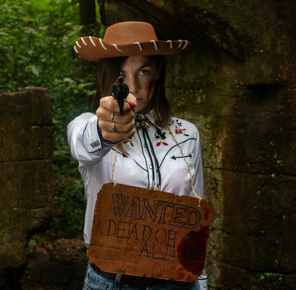 Dead Cowgirl stares down the barrel of a gun | Dead Cowgirl | Ethical Halloween | Ethical and sustainable fashion | Ethical and sustainable fancy dress | The Dopey vegan x The Revival Collective