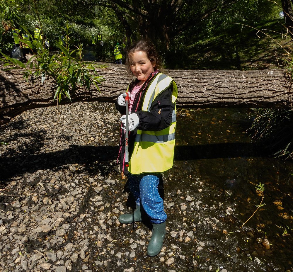 A volunteer in the river armed with a litter picker | The River Pool Spring Clean | Great British Spring Clean | Litter Picking