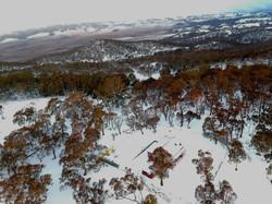 aerial shot in winter snow