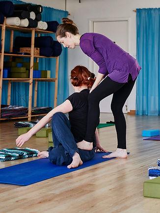 yoga-instructor-helping-student.jpg
