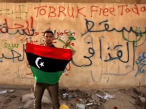 الربيع العربي يطيح بأعلام الدكتاتورية.