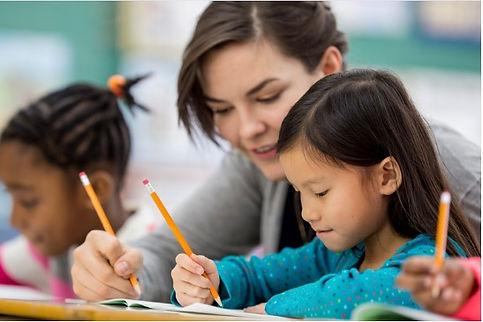 Teacher with Child Writing.jpg