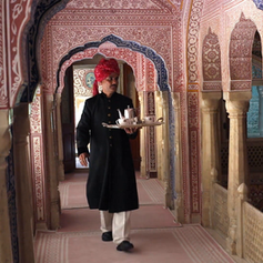 samode-palace-waiter-carrying-tea-tray-in-ornate-passageway-model-and-property-released_hszczoskz__F0008.png