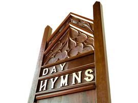 Close-up of carving on hymm stand