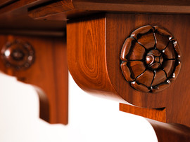 Close-up of carving on wall mounted table