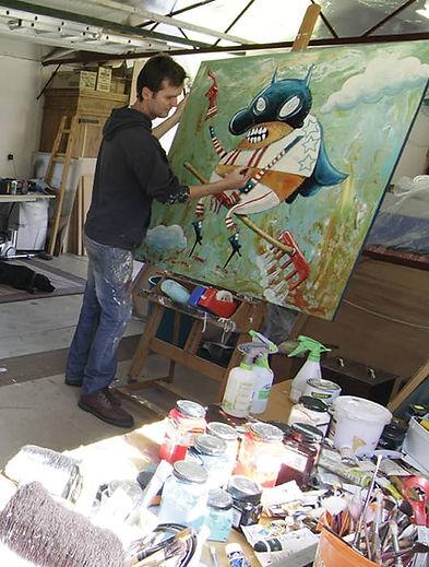 Neil painting in studio.jpg