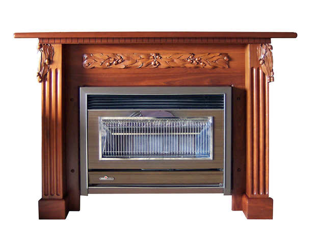 Contemporary Fire Surround with hand carved gumnuts and leaves