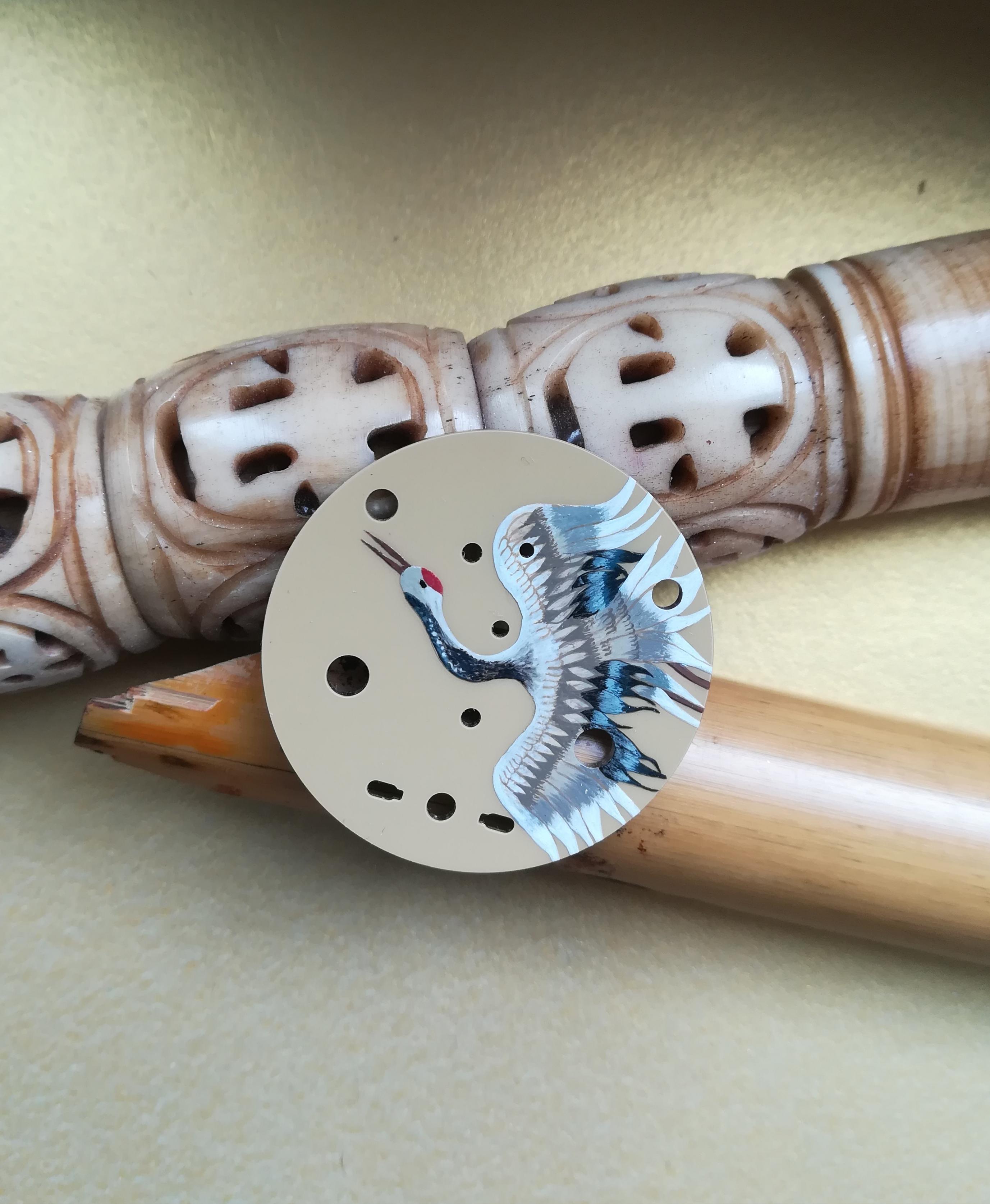 'Grue du Japon'sur cadran métal.