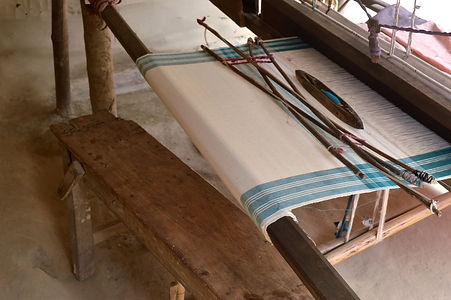cotton cloth on a handloom in an Assamese village