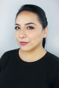Classic makeup with a pink lip, makeup done by artist Melina Tobin