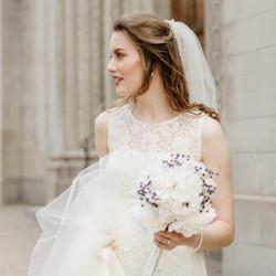 A bride glances over her shoulder, makeup done by artist Melina Tobin