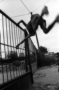 kid jumping fence