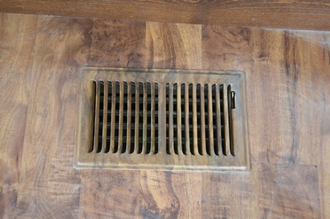 faux wood texture indoors with air conditioning vent