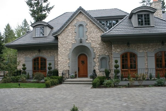 One story house with stone and wood accents front view