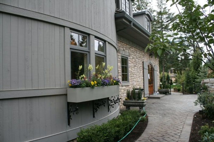 One story house with stone and wood accents side view
