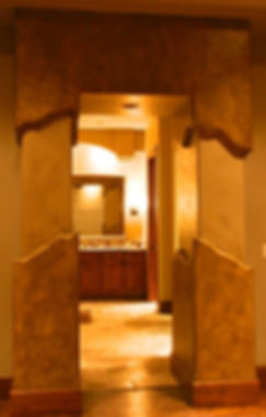 Bathroom with faux stone details and two columns