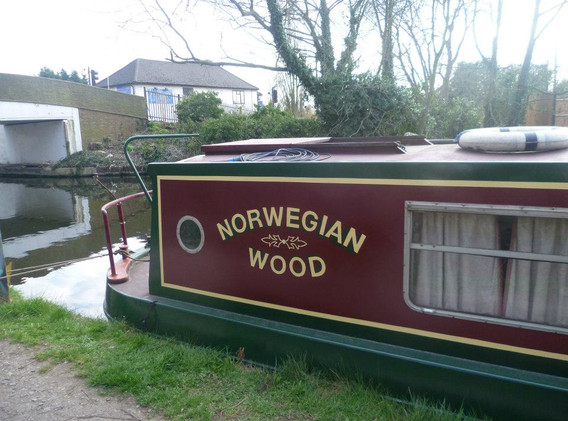 Professional boat painting and signwriting by Rebecca.