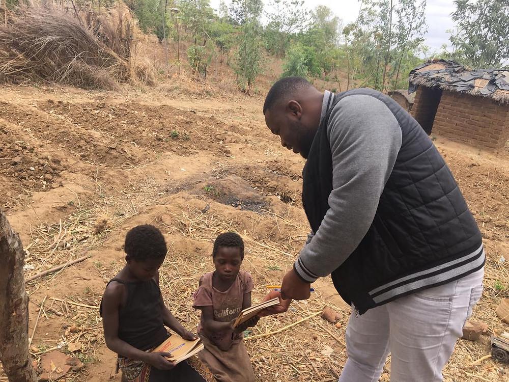 Two girls receiving School Supplies