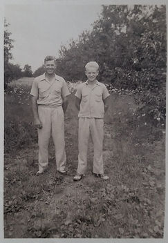 Edward N. Pearson and son Jack W. Pearson in the apple orchard