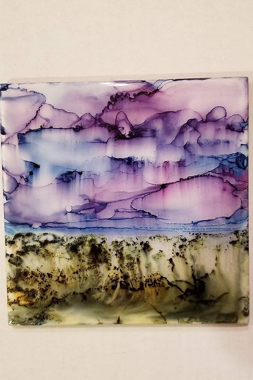 Alcohol ink landscape on tile with resin coat and cork back.