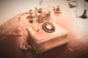 white and brown rotary telephone on brown wooden table_edited.jpg