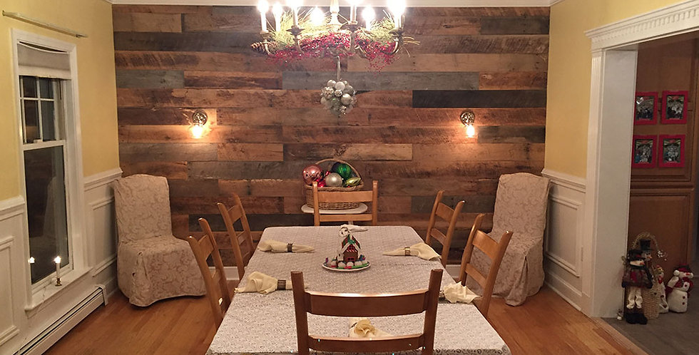 A dining room with reclaimed oak wall planks colored antique brown