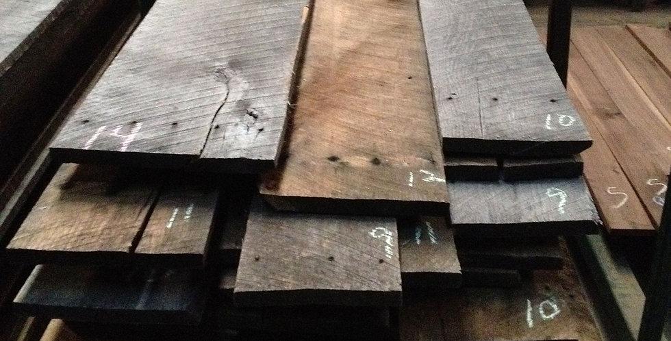 A pile of reclaimed oak lumber