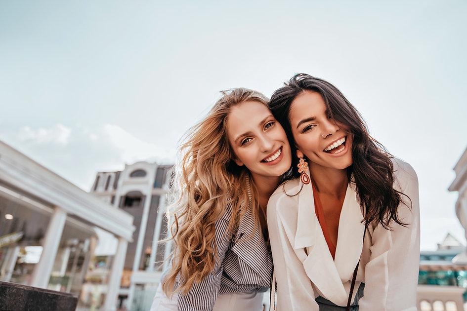 Ecstatic long-haired girls posing in spr