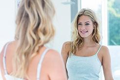 Smiling beautiful young woman looking at
