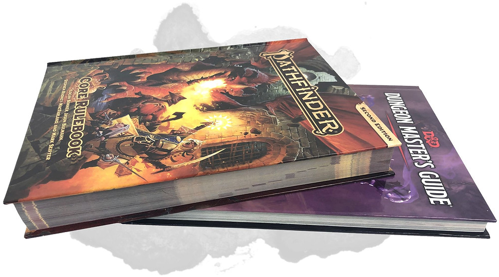 The Pathfinder 2e Core Rulebook on top of D&D 5e's Dungeon Master's Guide