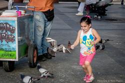 Girl Chasing Pigeons.jpg