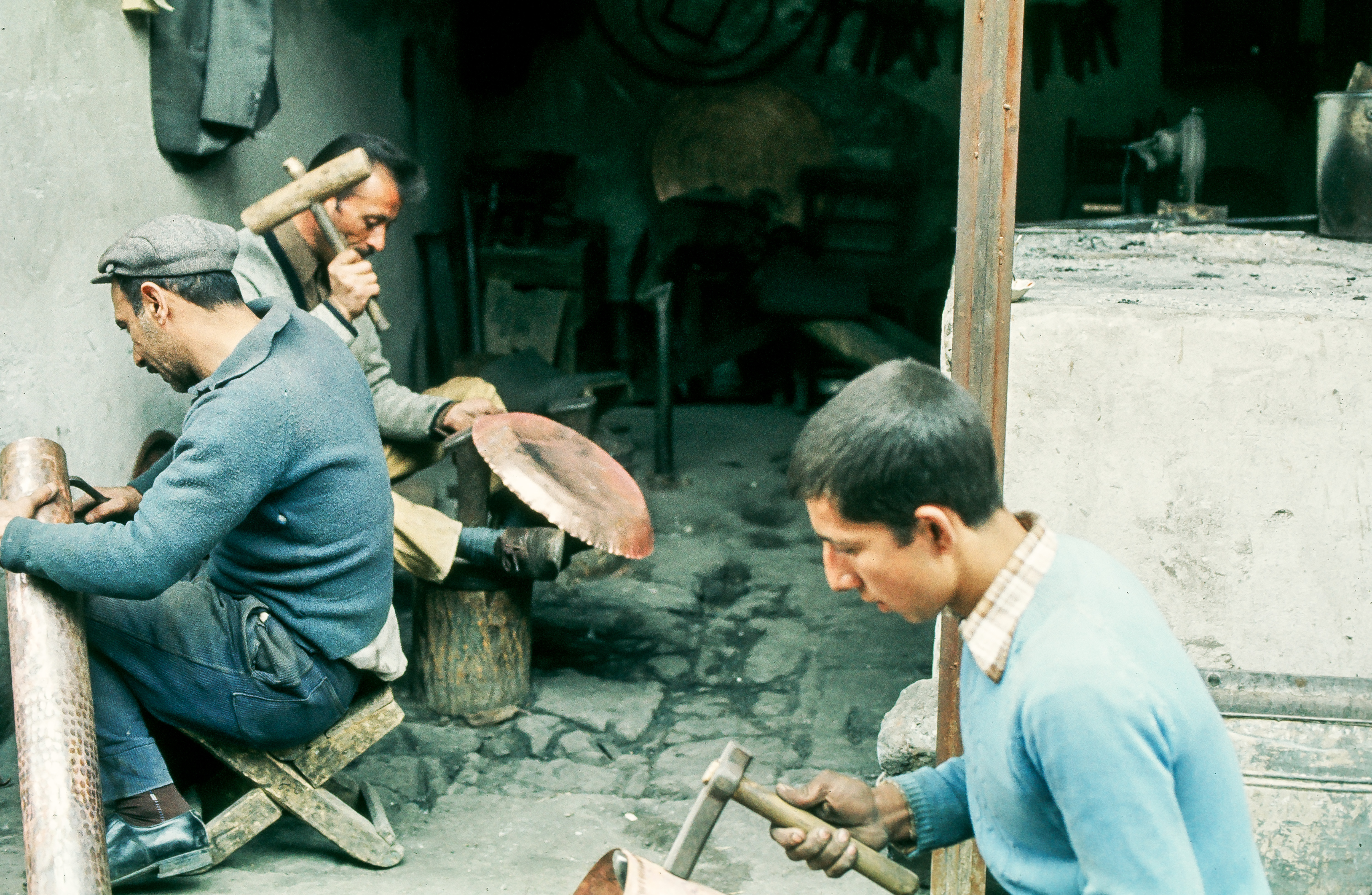 Family making cooking pots
