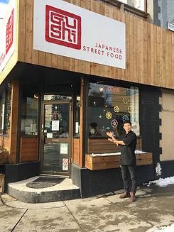 Gushi storefront with Shinji.JPG