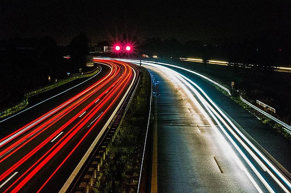 A time-lapse of a highway, all the headlights and brakelights simply beems of red and white light