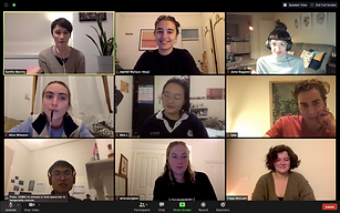 Nine people in a Zoom meeting smile out at each other