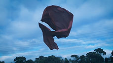 A piece of red fabric suspended in the air