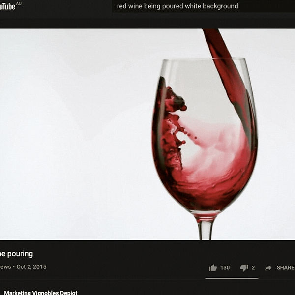 Red wine being poured into a wine glass