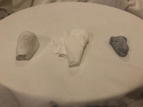Front view of three objects in a row on a white platter
