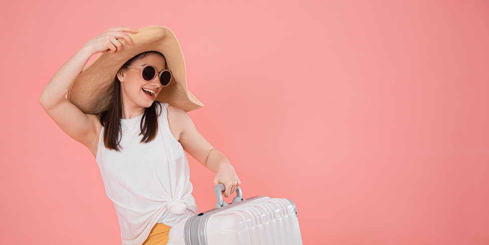 portrait-of-a-stylish-young-woman-in-a-hat-with-a-suitcase.jpg