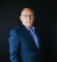 Photo of Alan Zimmerman in blue suit